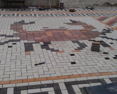 Проявите творческий подход с тротуарной плиткой.